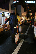 Mar 4, 2006; Tokyo, JPN; Tsukiji.A buyer drags away his recently purchased frozen tuna at the Tsukiji Fish Market...After tuna is caught, it is flash frozen at sea to keep it fresh until it is brought to the market to be sold...Photo credit: Darrell Miho