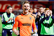 AFC Wimbledon goalkeeper George Long (1), on loan from Sheffield United,  cheers with the visiting fans after securing AFC Wimbledon League One status with a point during the EFL Sky Bet League 1 match between Doncaster Rovers and AFC Wimbledon at the Keepmoat Stadium, Doncaster, England on 1 May 2018. Picture by Simon Davies.