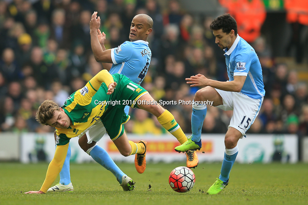 12 March 2016 - Barclays Premier League - Norwich City v Manchester City - Patrick Bamford of Norwich City in action with Vincent Kompany and Jesus Navas of Manchester City - Photo: Marc Atkins / Offside.