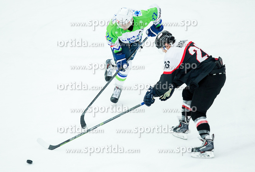 Marcel Rodman of Slovenia vs Yushiroh Hirano of Japan during ice-hockey friendly match between National teams of Slovenia and Japan, on April 10, 2015 in Arena Podmezakla, Jesenice, Slovenia. Photo by Vid Ponikvar / Sportida