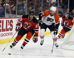 November 8, 2007; Newark, NJ, USA;  New Jersey Devils defenseman Johnny Oduya (29) skates away from the pursuit of Philadelphia Flyers left wing Ben Eager (55) during the first period at the Prudential Center in Newark, NJ.