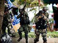 """Bangkok unrest. wed.19-2010<br /> <br /> In the early morning hours, the Thai goverment soldiers moved into the occupied """"red shirt"""" zone. fierce firefights broke out killing several soldiers and demonstrators. later in the afternoon, red shirts sat fire to the stockexchange and a shopping mall."""