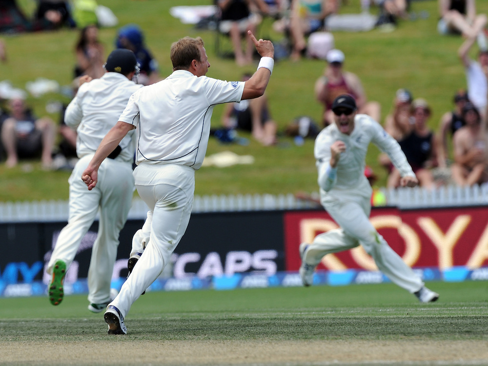 New Zealand's Neil Wagner celebrates the dismissal of Sri Lanka's Dinesh Chandimal for 4 caught by Martin Guptill on day three of the second International Cricket Test, Seddon Park, Hamilton, New Zealand, Sunday, December 20, 2015. Credit:SNPA / Ross Setford