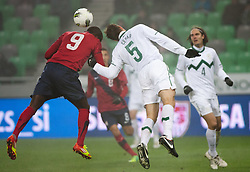 Jozy Altidore of USA vs Bostjan Cesar of Slovenia during friendly football match between National teams of USA and Slovenia, on November 15, 2011 in SRC Stozice, Ljubljana, Slovenia. USA defeated Slovenia 3-2. (Photo By Vid Ponikvar / Sportida.com)