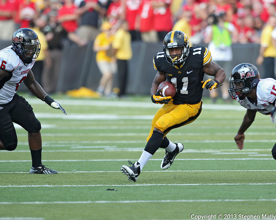 August 31 2013: Iowa Hawkeyes wide receiver Kevonte Martin-Manley (11) tries to avoid Northern Illinois Huskies linebacker Jamaal Bass (6) and Northern Illinois Huskies safety Jimmie Ward (15) during the second half of the NCAA football game between the Northern Illinois Huskies and the Iowa Hawkeyes at Kinnick Stadium in Iowa City, Iowa on August 31, 2013. Northern Illinois defeated Iowa 30-27.