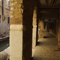 Italian buildings with walkway under arches