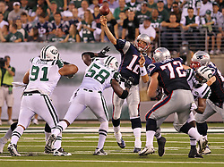 Sept 19, 2011; East Rutherford, NJ, USA; New England Patriots quarterback Tom Brady (12) throws a pass while under pressure from New York Jets linebacker Bryan Thomas (58) during the 2nd half at the New Meadowlands Stadium.  The Jets defeated the Patriots 28-14.