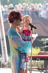 Image ©Licensed to i-Images Picture Agency . 18/07/2014 . Henham Park , Suffolk , United Kingdom . Pop star LILY ALLEN making an unannounced appearance for television's the Andrew Marr Show , on The Waterfront Stage . The Latitude Festival of music and arts with her daughter Marnie Rose Cooper. Picture by Joel Goodman/i-Images