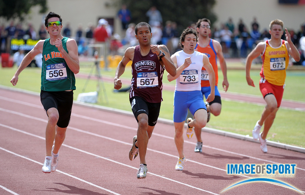 May 26, 2012; Claremont, CA, USA; Kevin Cunningham of McMurry (second from left) defeats Marcus Fortugno of La Verne (left) to win the 400m, 46.98 to 47.16, in the 2012 NCAA Division III Track & Field Championships at Claremont-Mudd-Scripps College. From left: Fortugno and Cunningham and Mark Williams of Wheaton and Ben Williams of Wisconsin Platteville and Ben Coy of Simpson.