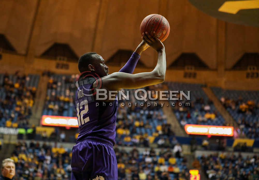 Feb 12, 2018; Morgantown, WV, USA; TCU Horned Frogs forward Kouat Noi (12) shoots a three pointer during the first half against the West Virginia Mountaineers at WVU Coliseum. Mandatory Credit: Ben Queen-USA TODAY Sports