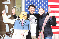 Jan. 20, 2009; Obama, Fukui Prefecture, Japan - (L-R) TV Kanazawa reporter Shoko Hashinaga (wearing Obama mask), Tatsuya Sano (owner of Wakasaya) and Sara Wall pose for the TV camera in front of Wakasaya on the day of the inauguration of President Barack Obama.