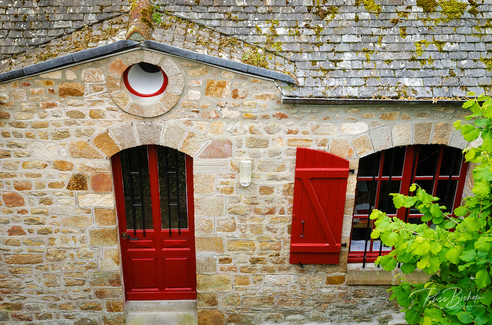 Courtyard and red door, Mont Saint-Michel, Normandy, France