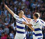 Loftus Road, London - Saturday 11th September 2010: Heidar Helguson (9) of QPR (L) and Fitz Hall (5) of QPR (R) celebrate their first goal during the Npower Championship match between Queens Park Rangers and Middlesborough. (Photo by Andrew Tobin/Focus Images)