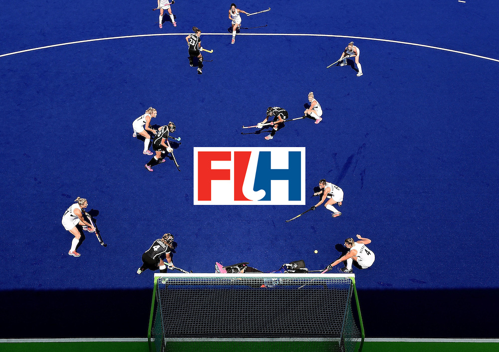 Germany's goalkeeper Kristina Reynolds (bottom C) stops a shot on goal from New Zealand's Kayla Whitelock (top C) during the women's Bronze medal hockey match between Germany and New Zealand of the Rio 2016 Olympic Games at the Olympic Hockey Centre in Rio de Janeiro on August 19, 2016. / AFP / MANAN VATSYAYANA        (Photo credit should read MANAN VATSYAYANA/AFP/Getty Images)