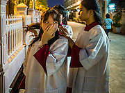 25 MARCH 2016 - BANGKOK, THAILAND: Altar attendants prepare for Good Friday observances at Santa Cruz Church in Bangkok. Santa Cruz was one of the first Catholic churches established in Bangkok. It was built in the late 1700s by Portuguese soldiers allied with King Taksin the Great in his battles against the Burmese who invaded Thailand (then Siam). There are about 300,000 Catholics in Thailand, in 10 dioceses with 436 parishes. Good Friday marks the day Jesus Christ was crucified by the Romans and is one of the most important days in Catholicism and Christianity.        PHOTO BY JACK KURTZ