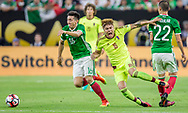 Venezuelan foward Adalberto Peñaranda, center, gets dispossessed from the ball by Mexican defensive midfielder Hector Herrera during a group stage match of the Copa America Centenario played at NRG Stadium in Houston, Texas, on Monday June 13, 2016.