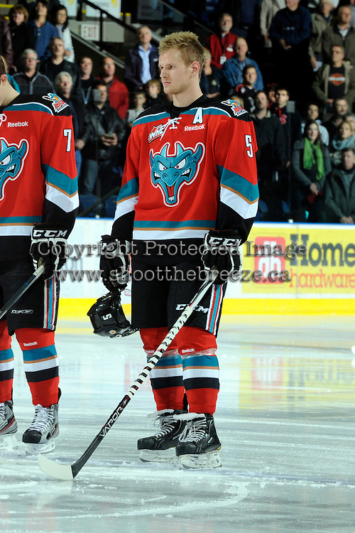 KELOWNA, CANADA, OCTOBER 26:  Mitchell Chapman #5 of the Kelowna Rockets lines up against the Prince George Cougars  on October 26, 2011 at Prospera Place in Kelowna, British Columbia, Canada (Photo by Marissa Baecker/Shoot the Breeze) *** Local Caption *** Mitchell Chapman;