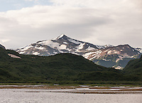 Snow covered mountains and shore line, Katmai National Park, Alaska, USA.