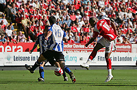 Photo: Lee Earle.<br /> Charlton Athletic v Sheffield Wednesday. Coca Cola Championship. 25/08/2007.Charlton's Chris Iwelumo (R) fires home their second goal.