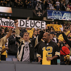 2008 December, 28: New Orleans Saints fans hold up a sign in tribute of Saints running back Deuce McAllister (not pictured) during a week 17 game between NFC South divisional rivals the Carolina Panthers and the New Orleans Saints at the Louisiana Superdome in New Orleans, LA.