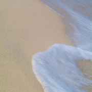 Wave brushing the sand. Cancun, Quintana Roo, Mexico.