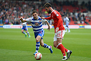 Nottingham Forest defender Danny Fox (13) battles with Reading striker Adrian Popa (25) during the EFL Sky Bet Championship match between Nottingham Forest and Reading at the City Ground, Nottingham, England on 22 April 2017. Photo by Jon Hobley.