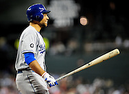 Sep. 27 2011; Phoenix, AZ, USA; Los Angeles Dodgers infielder James Loney (7) reacts while at bat during the sixth inning against the Arizona Diamondbacks at Chase Field.  Mandatory Credit: Jennifer Stewart-US PRESSWIRE.