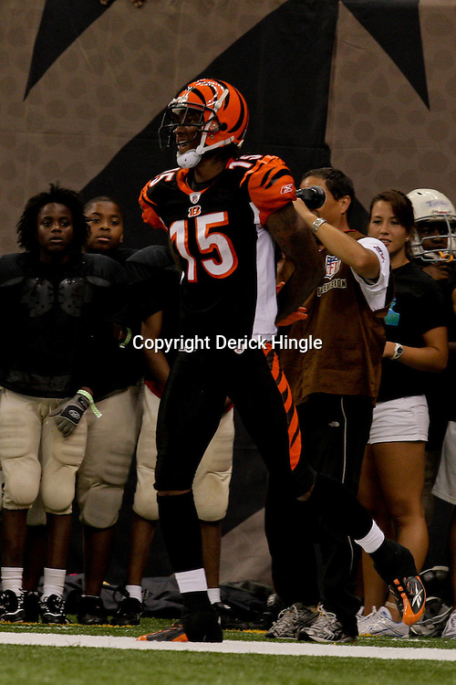 2009 August 14: Cincinnati Bengals wide receiver Chris Henry (15) born in Belle Chasse, Louisiana celebrates after scoring a touchdown during a preseason opener between the Cincinnati Bengals and the New Orleans Saints at the Louisiana Superdome in New Orleans, Louisiana.  Henry died on the morning of December 17, 2009 after suffering injuries he sustained after falling from the back of a pick up truck, Henry was 26-years old.