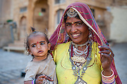 Rajasthani tribal woman with daughter (India)