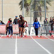 23 March 2018: Lisa-Anne Barrow in lane one and Jalyn Harris in lane three compete in the 100 meter dash open event Friday morning at 40th Annual Aztec Invitational.<br /> More game action at sdsuaztecphotos.com