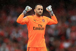 Arsenal goalkeeper David Ospina celebrates his side's fourth goal of the game during the Emirates Cup match at the Emirates Stadium, London.