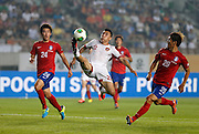 China's Yu Dabao (C) controls the ball to shoot as South Korea's Jang Hyun-soo (L) and Lee Yong (R) look on, during their East Asian Cup soccer championship match in Hwaseong, south of Seoul July 24, 2013. Photo by Lee Jae-Won (SOUTH KOREA) www.leejaewonpix.com/