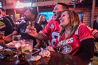 Locals Bill Powell, Chris McAllister and Dana Tanner Powell celebrate on Super Bowl Sunday at Susie's Bar on Lincoln Avenue in Calistoga