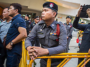 "14 FEBRUARY 2015 - BANGKOK, THAILAND:  Thai police watch protestors Saturday. Dozens of people gathered in front of the Bangkok Art and Culture Centre in Bangkok Saturday to hand out red roses and copies of George Orwell's ""1984."" Protestors said they didn't support either Red Shirts or Yellow Shirts but wanted a return of democracy in Thailand. The protest was the largest protest since June 2014, against the military government of General Prayuth Chan-Ocha, who staged the coup against the elected government. Police made several arrests Saturday afternoon but the protest was not violent.     PHOTO BY JACK KURTZ"