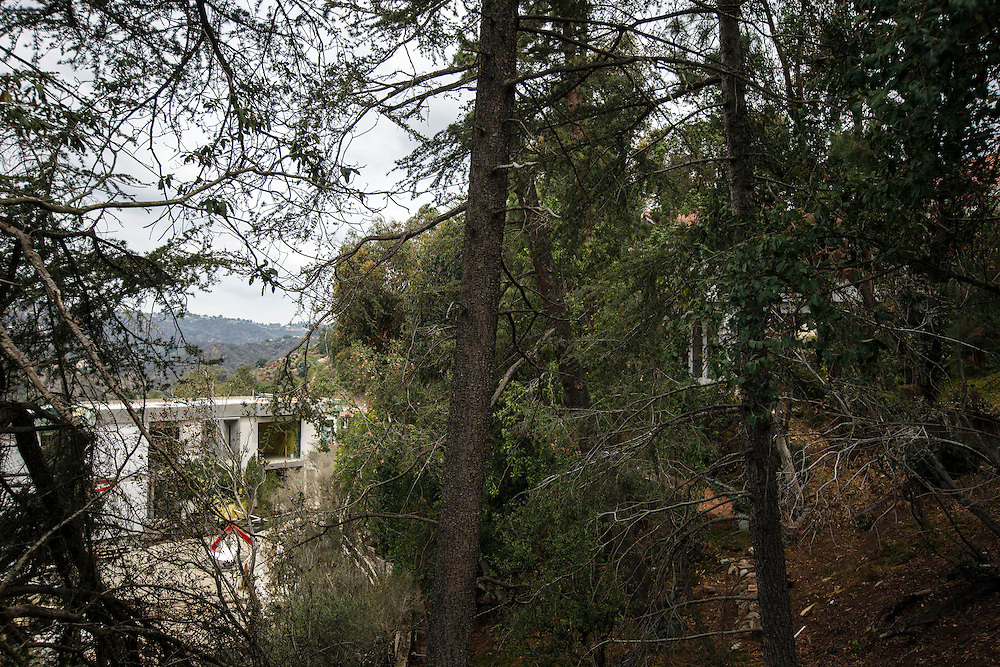 The home of Carole Cramer, right, sits above the home of Mohamed Hadid, left, under construction at 901 Strada Vecchia in the Bel Air neighborhood of Monday, July 20, 2015 in Los Angeles, California. Photo by Patrick T. Fallon for DailyMail.com