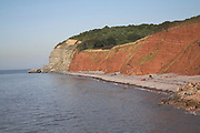 Old red sandstone cliffs looking towards a geological fault line shown by change in rock type, Watchet, Somerset, England