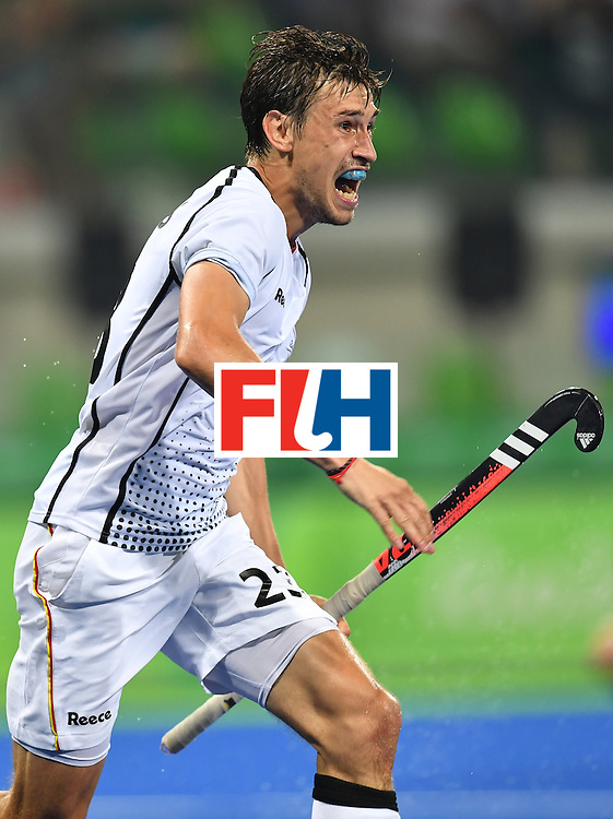 Germany's Florian Fuchs celebrates his team's third goal during the men's quarterfinal field hockey Germany vs New Zealand match of the Rio 2016 Olympics Games at the Olympic Hockey Centre in Rio de Janeiro on August 14, 2016. / AFP / MANAN VATSYAYANA        (Photo credit should read MANAN VATSYAYANA/AFP/Getty Images)