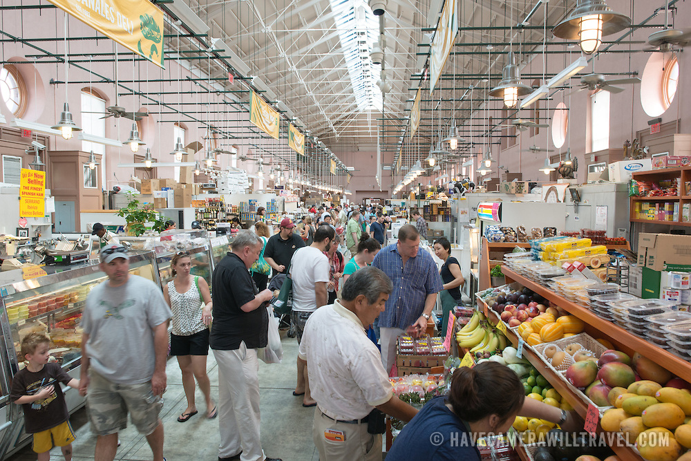A bustling morning at Eastern Market, an historic market on Capitol Hill in Washington DC. The original market building was badly damaged by fire in 2007, and the rebuilt building was reopened in 2009.