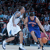 06 October 2010: New York Knicks forward Danilo Gallinari #8 drives past Minnesota Timberwolves forward Michael Beasley #8 during the Minnesota Timberwolves 106-100 victory over the New York Knicks, during 2010 NBA Europe Live, at the POPB Arena in Paris, France.