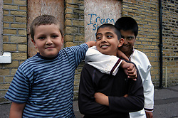 Children playing in street together in deprived part of Halifax; Yorkshire UK