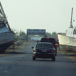 Scenes of devastation left in the aftermath of Hurricane Katrina that flooded the small city of Buras, Louisiana in Plaquemines Parish on August 29, 2005. Boats settled near the road following the receding of the flood waters in the Empire, Louisiana area. ..(Mandatory Credit: Photo by Derick E. Hingle)
