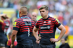 Owen Farrell (Saracens) stands dejected after the final whistle - Photo mandatory by-line: Patrick Khachfe/JMP - Tel: Mobile: 07966 386802 31/05/2014 - SPORT - RUGBY UNION - Twickenham Stadium, London - Saracens v Northampton Saints - Aviva Premiership Final.