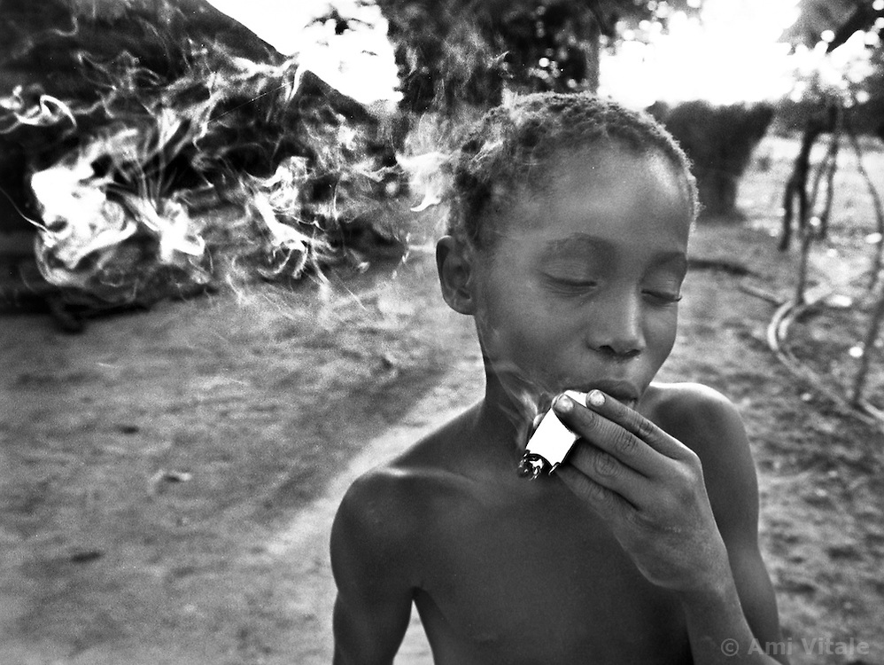 Alio Balde mimics his older brother and makes a fake cigarette out of grass and paper. Increasingly, the boys are moving to the capital of Bissau and abandoning the duties of the village life. Guinea Bissau is ranked as one of the poorest nations in the world and has just come out of a civil war but still village life has remained mostly untouched from most modern influences