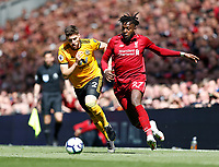 Football - 2018 / 2019 Premier League - Liverpool vs. Wolverhampton Wanderers <br /> <br /> Divock Origi of Liverpool vies with Matt Doherty of Wolverhampton Wanderers, at Anfield<br /> <br /> COLORSPORT/BRUCE WHITE
