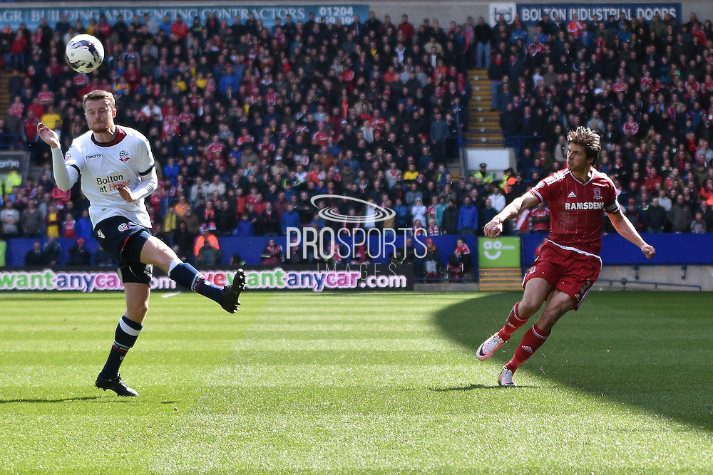 Middlesbrough Defender, George Friend crosses during the Sky Bet Championship match between Bolton Wanderers and Middlesbrough at the Macron Stadium, Bolton, England on 16 April 2016. Photo by Mark Pollitt.