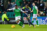 Mickel Miller (#11) of Hamilton Academical FC attempts to pull back Stephane Omeonga (#40) of Hibernian FC during the Ladbrokes Scottish Premiership match between Hibernian FC and Hamilton Academical FC at Easter Road Stadium, Edinburgh, Scotland on 22 January 2020.