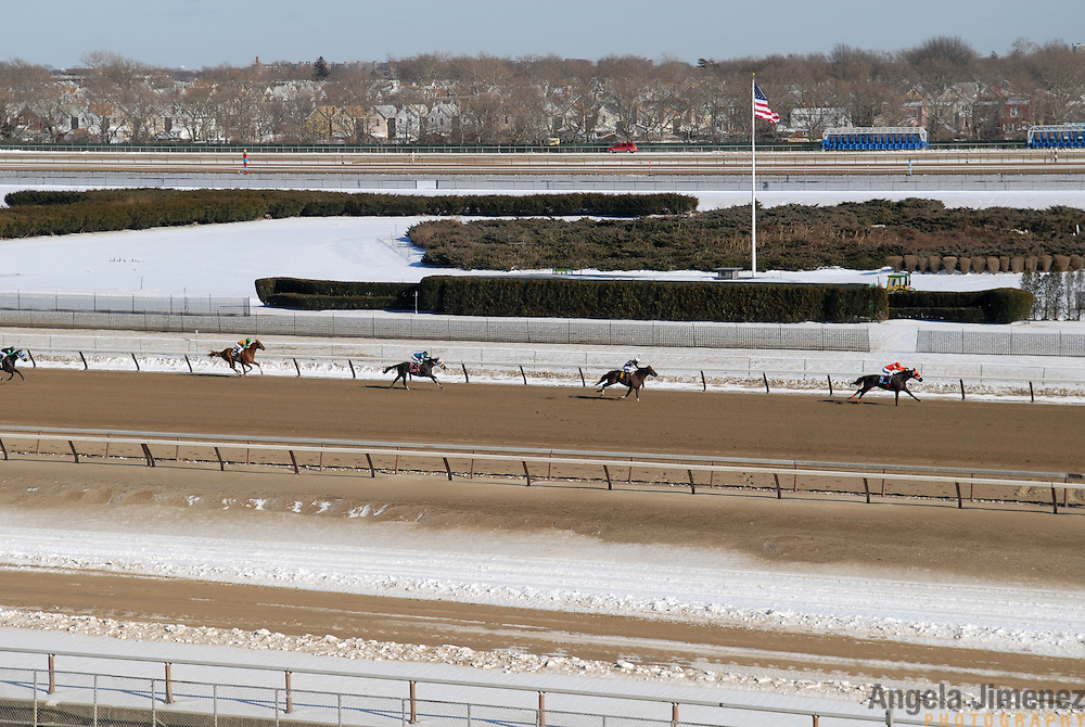 A race runs on the winterized inner dirt track at the Aqueduct racetrack, just days after the first real winter storm in New York City closed the track for a day. The outer dirt track and inner turf track await warmer days. Jockeys can make a call not to race- but all nine races ran on this day, when the high hit just 23 degrees...Betting on the horses is still a popular game and the money still flows, but off track betting and other forms of entertainment have eroded live attendance at the races.  The daily diehard betters and horse lovers who sparsely populate the place on work days are joined by a bigger crowd on the weekends. ..The Aqueduct, located in Ozone Park, Queens, is the only horse racing track in New York City and probably the coldest in the country (most of the others are in Kentucky, Florida or California). Horses race on the winterized inner dirt rack from January 1st through the end of April. Aqueduct was built in 1894, renovated in 1959, then opened for winter racing in 1975. It is the winter race track operated by the New York Racing Association (NYRA), which also runs Belmont and Saratoga in the warm seasons. Betters at Aqueduct watch and bet on the nine daily live races and all other races around the country via Simulcast. ..