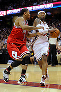 Apr 19, 2010; Cleveland, OH, USA; Cleveland Cavaliers guard Mo Williams (2) drives around Chicago Bulls guard Derrick Rose (1) during the second period in game two in the first round of the 2010 NBA playoffs at Quicken Loans Arena. Mandatory Credit: Jason Miller-US PRESSWIRE