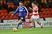 Harry Forrester of Doncaster Rovers under attack from Harry Middleton of Doncaster Rovers during the Sky Bet League 1 match between Doncaster Rovers and Chesterfield at the Keepmoat Stadium, Doncaster, England on 24 November 2015. Photo by Ian Lyall.