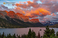 Vivid sunrise clouds over Wild Goose Island on St Mary Lake in Glacier National Park, Montana, USA